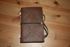 "Leather, hand-made journal for my husband...""Othala"" is the rune on the front cover..."